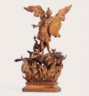 A CARVED FRUITWOOD GROUP OF ST