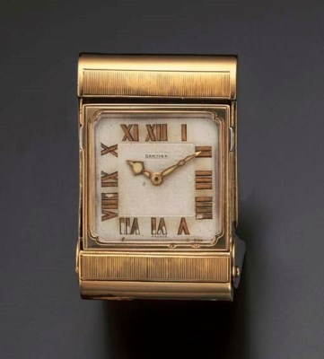 A TRAVELLING CLOCK, BY CARTIER