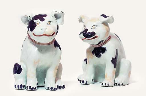 A pair of Arita models of pupp