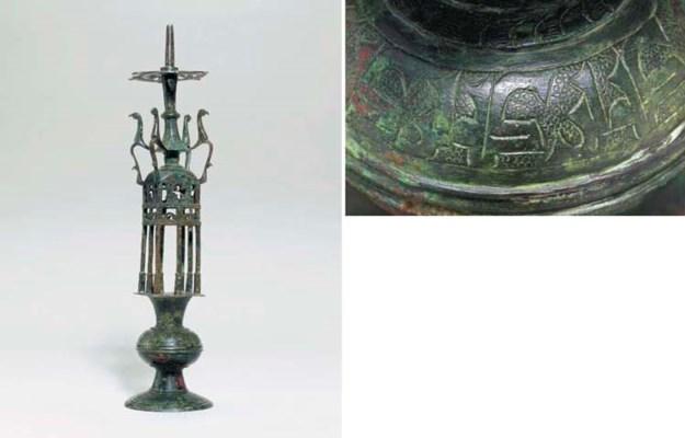 AN UMAYYAD BRONZE LAMP HOLDER