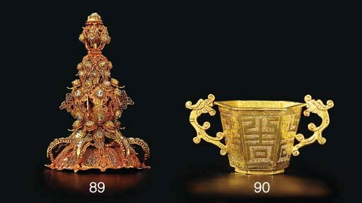 A GOLD TWO-HANDLED HEXAGONAL C