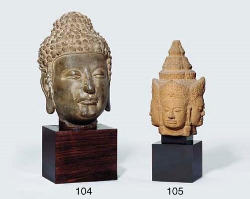 A GREY SANDSTONE HEAD OF BUDDH