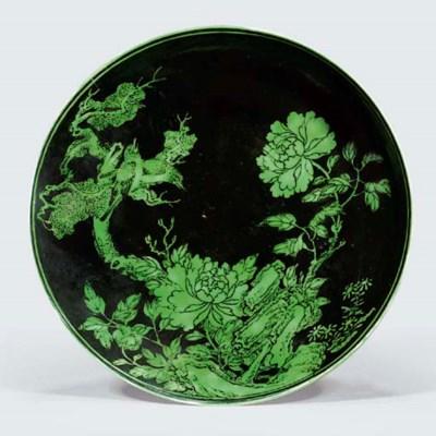 A RARE BLACK-GROUND GREEN-ENAM