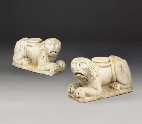 A PAIR OF CARVED MARBLE LIONS