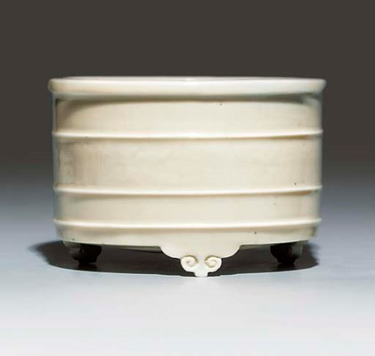 A BLANC-DE-CHINE RIBBED CYLIND