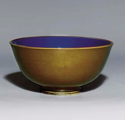 AN OLIVE-GREEN AND BLUE-GLAZED