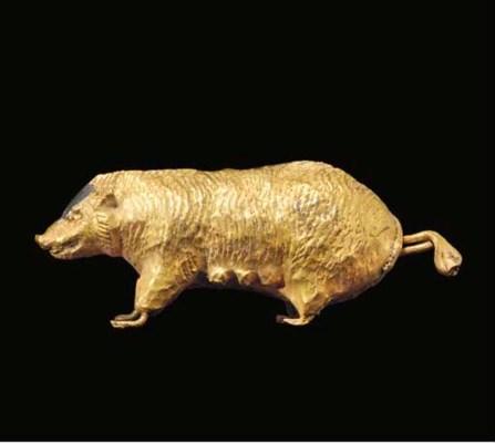 A GREEK SHEET GOLD FIGURE OF A