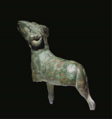 A GREEK BRONZE FIGURE OF A BLE