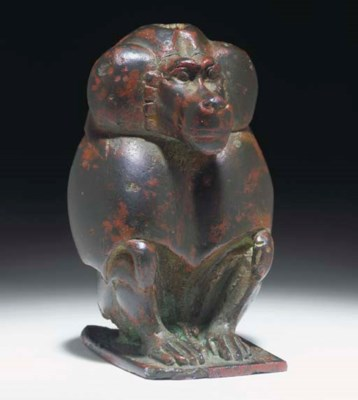 AN EGYPTIAN BRONZE FIGURE OF A