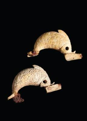 TWO GREEK BONE DOLPHIN FIBULAE