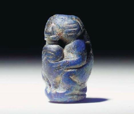 AN EGYPTIAN LAPIS LAZULI BARRE