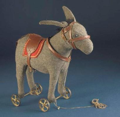 A Steiff Donkey on wheels