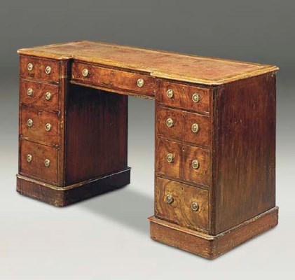 A LATE VICTORIAN WALNUT KNEEHO