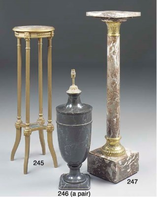 A giltwood and marble torchere
