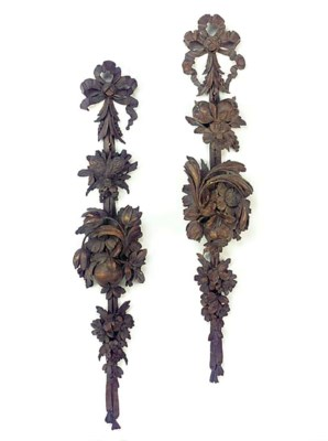 Two carved and stained wood wa