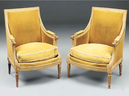 A pair of beech and upholstere