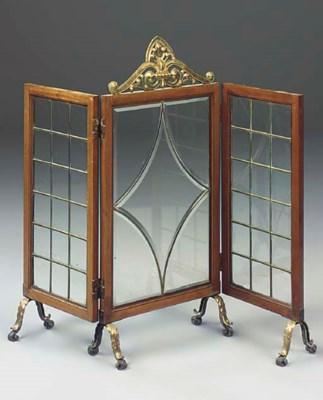 A mahogany and brass three-fol