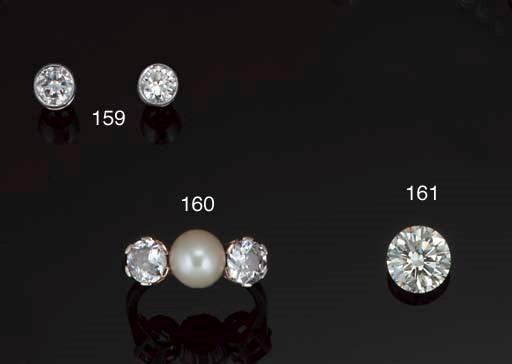 A pair of diamond single stone