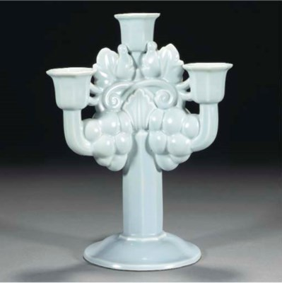 A POOLE POTTERY CANDELABRA BY