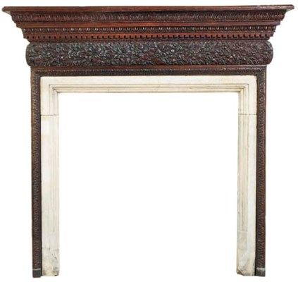 AN ENGLISH OAK CHIMNEYPIECE
