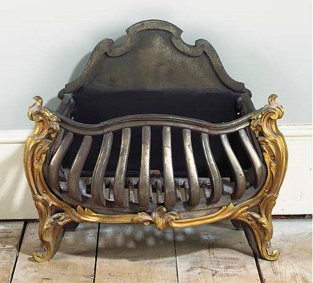 A CAST IRON AND BRASS MOUNTED