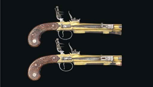 A PAIR OF BRASS FLINTLOCK TRAV
