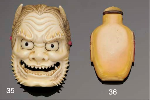 A large Japanese ivory mask ne