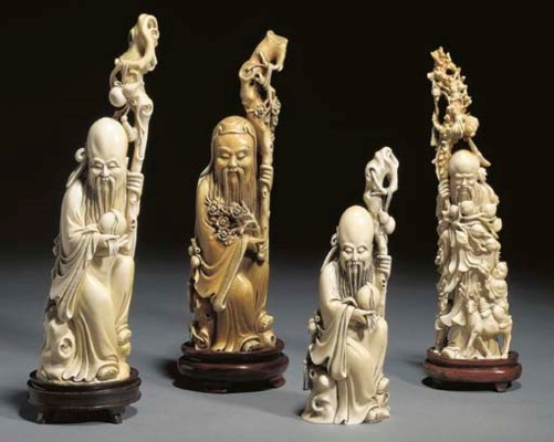 A group of four Chinese ivory