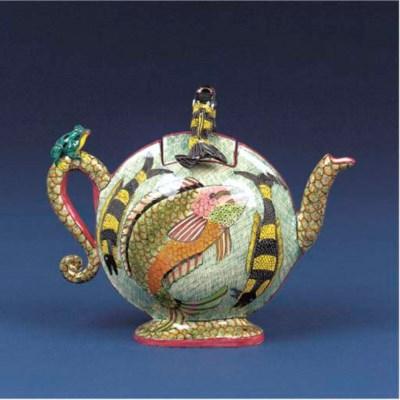 A fish tea pot and cover