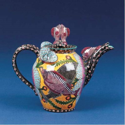 A fish coffee pot and cover