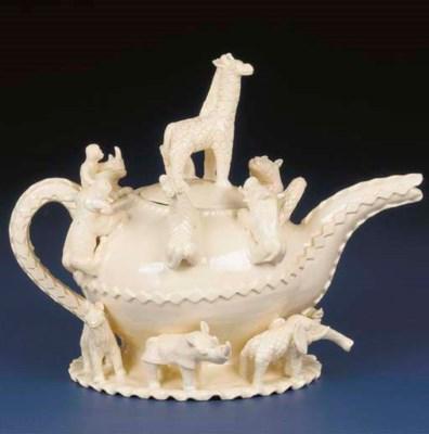 A white animal tea pot and cov