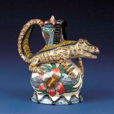 A crocodile tea pot and cover