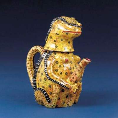 A crocodile tea pot and cover