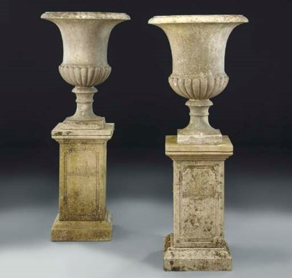 A PAIR OF WHITE MARBLE URNS