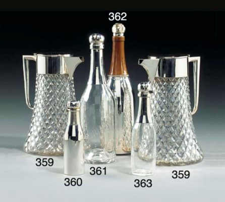 A SILVER AND GLASS DECANTER