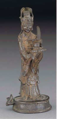 A Chinese bronze standing figu
