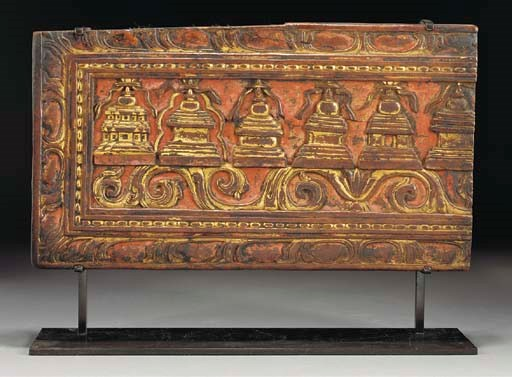 A Tibetan carved, painted and