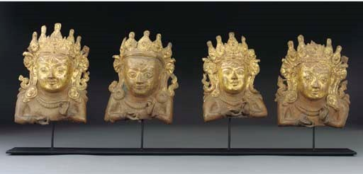 Four Nepalese repousse gilt-co