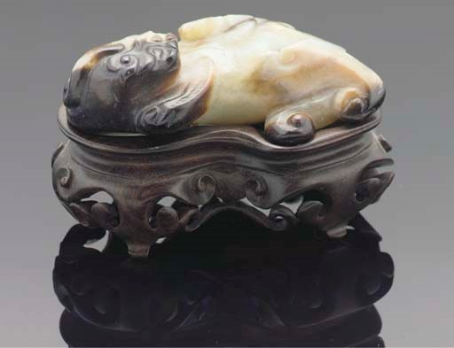A Chinese pale celadon and rus
