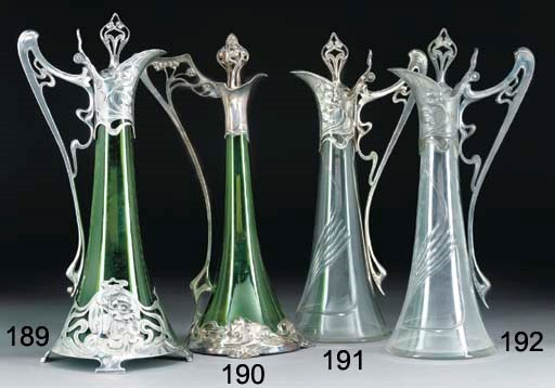 A PEWTER AND CLEAR GLASS CLARE