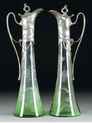 A PAIR OF SILVERED METAL AND E