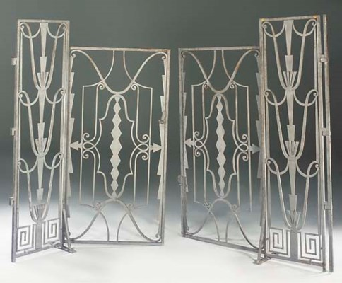 A PAIR OF WROUGHT-IRON GATES