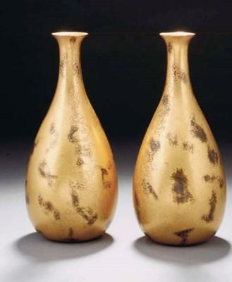 A pair of gilt bronze vases