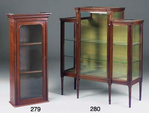A mahogany breakfront display
