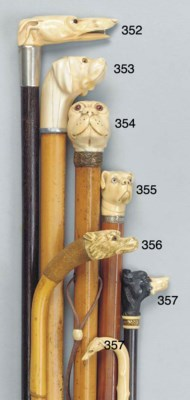 A carved ivory mounted malacca