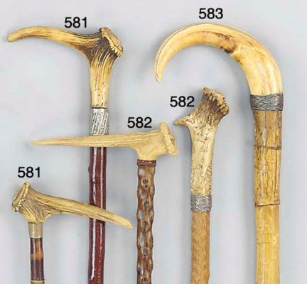 A Continental carved antler mo