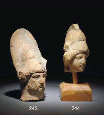 A ROMAN MARBLE HEAD OF ATHENA