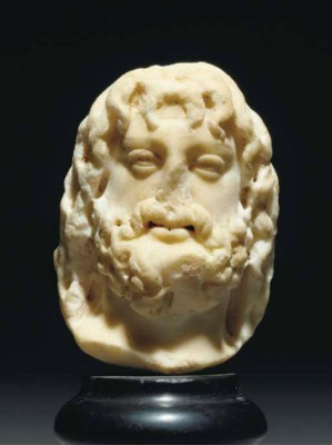 A ROMAN MARBLE HEAD OF ZEUS-SE