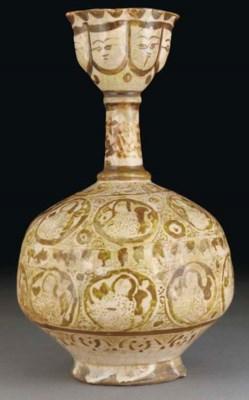 A Kashan lustre pottery bottle