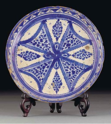 A Moroccan blue and white pott